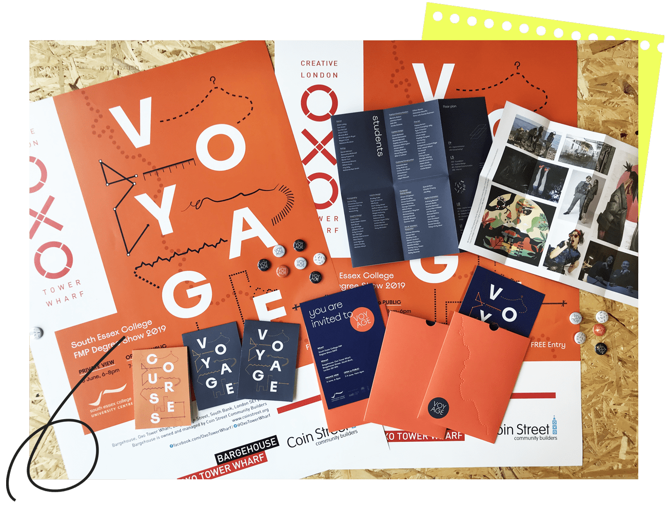 Voyage Exhibition printed materials laid out on a table - poster, leaflet, invite and custom badges