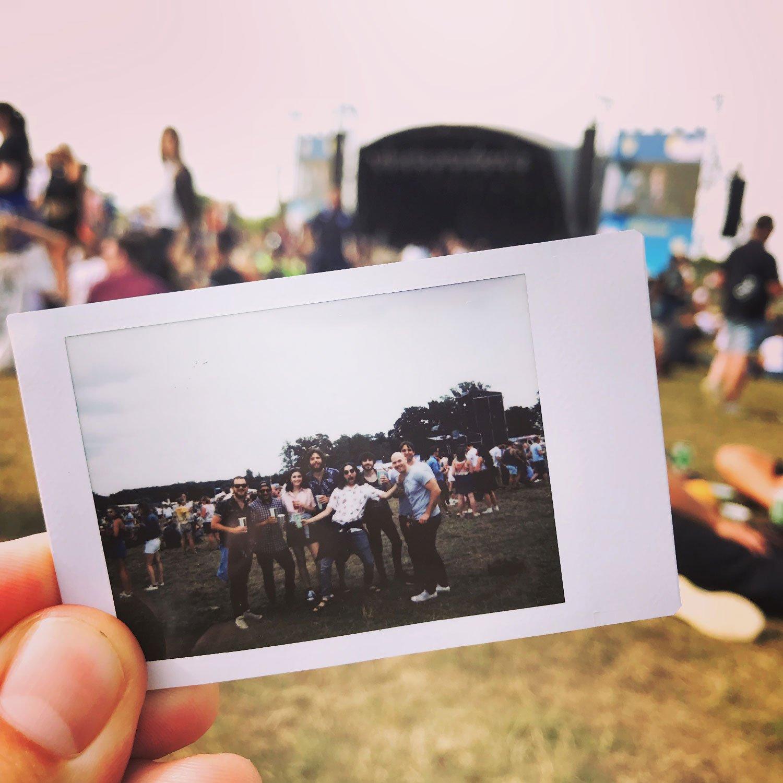 6rs team at rise festival on a polaroid photo
