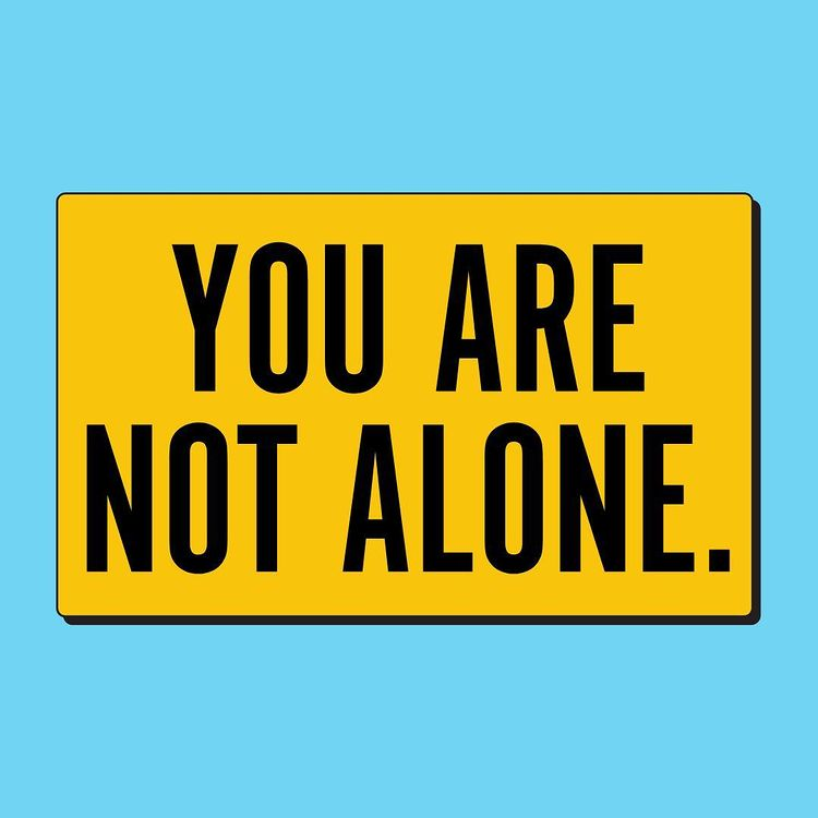 'You are not alone' colourful typography in caps