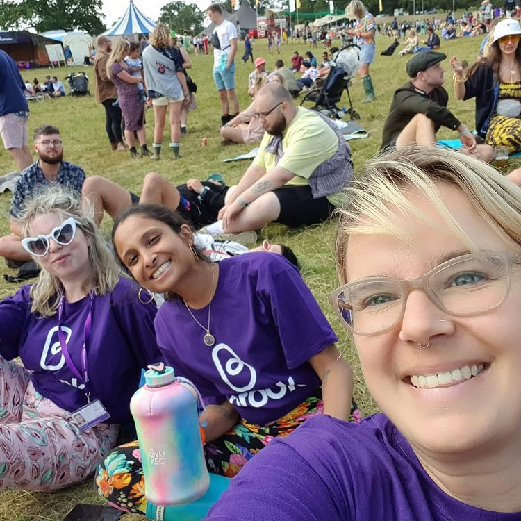 Brook staff at a festival wearing Brook branded purple t-shirts